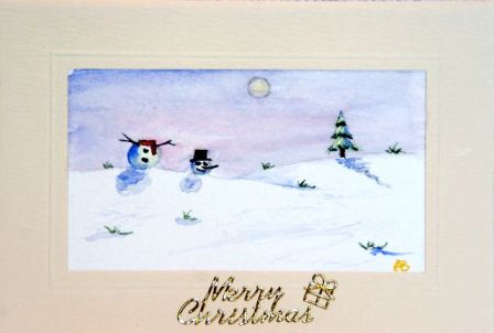 snowman card with his head rolling down the hill
