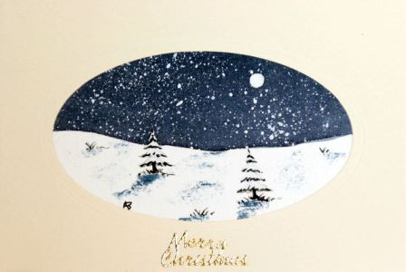 Snowfall over the trees christmas card
