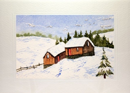 Christmas card showing Snow covered log cabins
