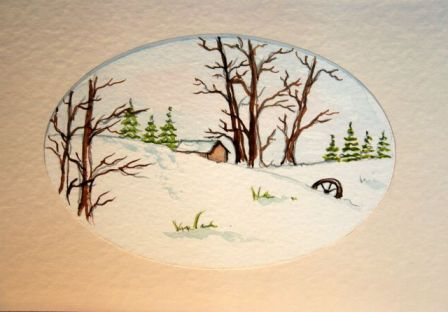 Christmas card scene showing cabin in the snow