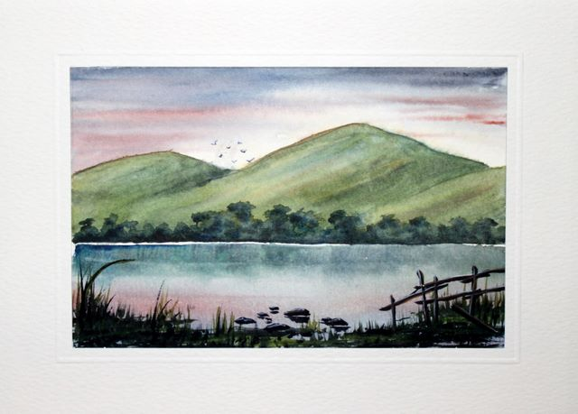 Rolling hills down to a still lake watercolour greeting card
