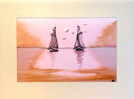 Two tall sail boats on the sea