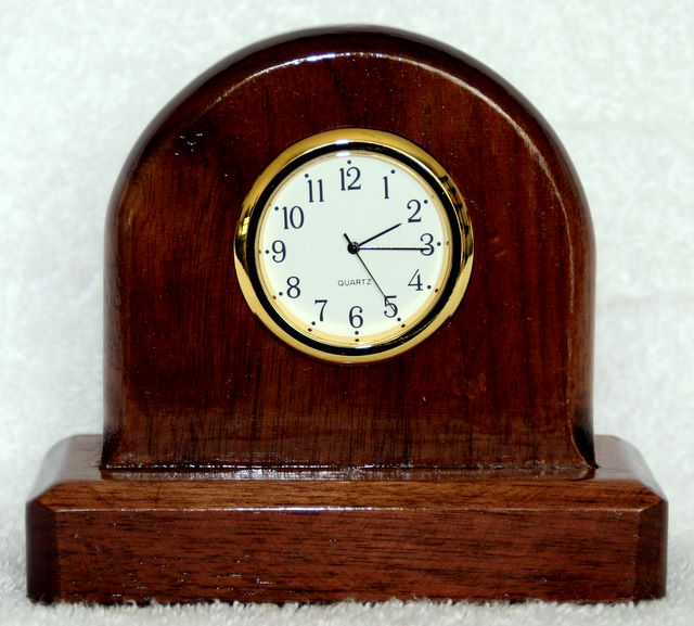 mantle clock made from walnut, Gold coloured rim and white face