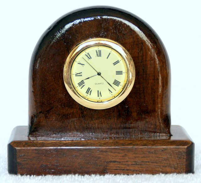 little mantle clock made from walnut, Gold coloured rim and cream face
