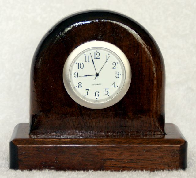 little mantle clock made from walnut, Silver coloured rim and white face