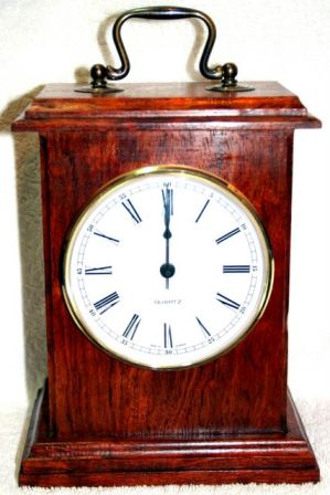 hand made carriage clock made from Bubinga wood, Gold plated face and brass handle with Roman numerals.